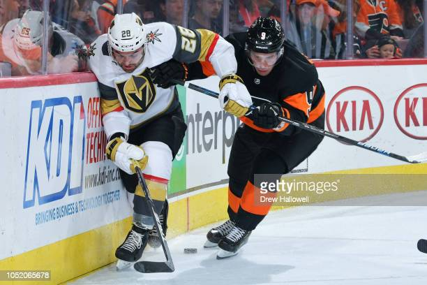 William Carrier of the Vegas Golden Knights and Ivan Provorov of the Philadelphia Flyers fight for the puck at the Wells Fargo Center on October 13...