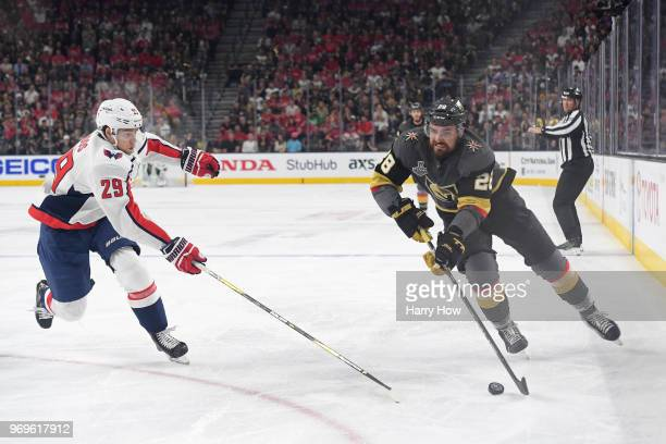 William Carrier of the Vegas Golden Knights is defended by Christian Djoos of the Washington Capitals during the first period in Game Five of the...