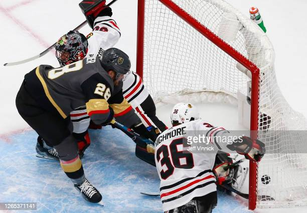 William Carrier of the Vegas Golden Knights scores a goal Corey Crawford and Matthew Highmore of the Chicago Blackhawks during the second period in...