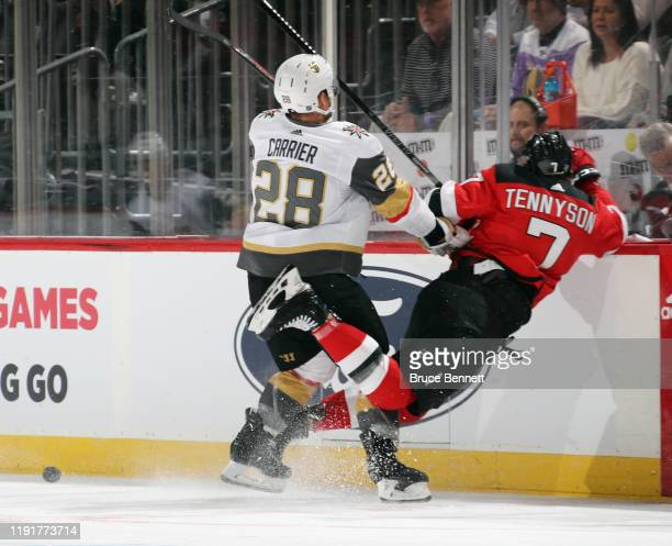 William Carrier of the Vegas Golden Knights takes a first period penalty for boarding Matt Tennyson of the New Jersey Devils at the Prudential Center...