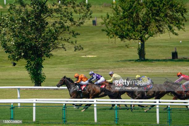 William Carson riding Street Parade win The Tellisford Handicap at Sandown Park Racecourse on July 22, 2021 in Esher, England.
