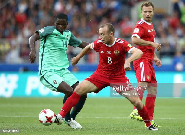 William Carvalho of Portugal and Dennis Glushakov of Russia battle for possession during the FIFA Confederations Cup Russia 2017 Group A match...