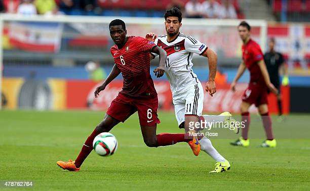 William Carvalho of Portugal and Emre Can of Germany battle for the ball during the UEFA European Under21 semi final match Between Portugal and...