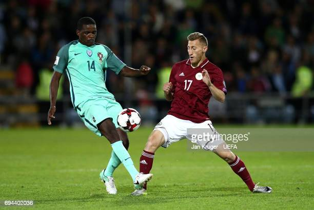 William Carvalho of Portugal battles with Edgars Vardanjans of Latvia during the FIFA 2018 World Cup Qualifier between Latvia and Portugal at Skonto...