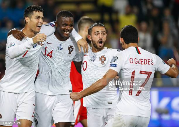 William Carvalho of Portugal celebrates after scoring a goal with Ronaldo and Bernardo Silva during the UEFA Euro 2020 qualifier between Serbia and...