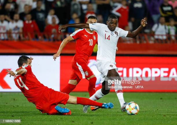 William Carvalho of Portugal in action against Luka Milivojevic of Serbia during the UEFA Euro 2020 qualifier between Serbia and Portugal at Stadium...