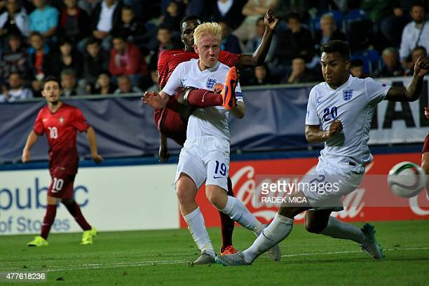 William Carvalho of Portugal shoots past Will Hughes and Liam Moore of England during the UEFA Under21 European Championship 2015 football match...