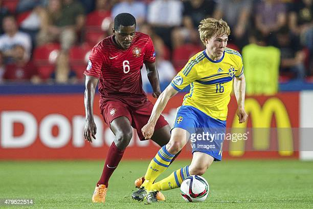 William Carvalho of Portugal Simon Tibbling of Sweden during the UEFA European Under21 Championship final match between Sweden and Portugal on June...