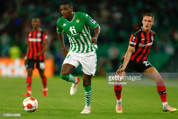 William Carvalho of Real Betis and Florian Wirtz of Bayer 04 Leverkusen during the UEFA Europa League match between Real Betis and Bayer 04...