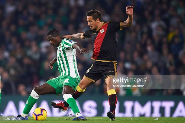 William Carvalho of Real Betis Balompie being followed by Oscar Guido Trejo of Rayo Vallecano during the La Liga match between Real Betis Balompie...