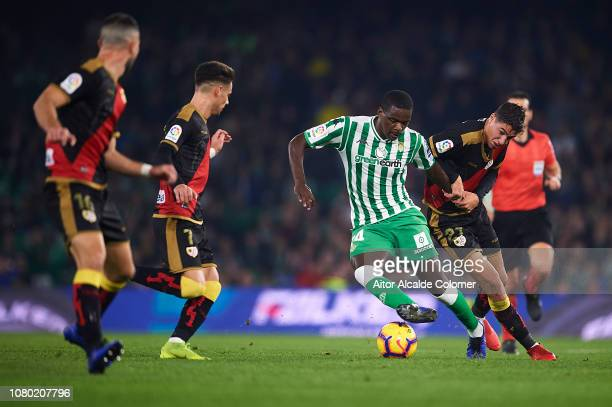 William Carvalho of Real Betis Balompie being followed by players of Rayo Vallecano during the La Liga match between Real Betis Balompie and Rayo...