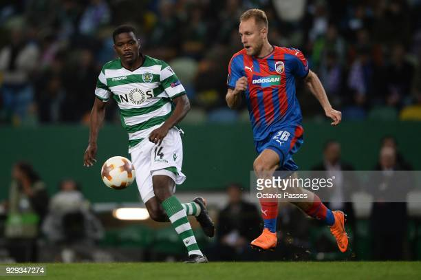 William Carvalho of Sporting Lisbon competes for the ball with Daniel Kolar of Viktoria Plzen during the UEFA Europa League Round of 16 first leg...