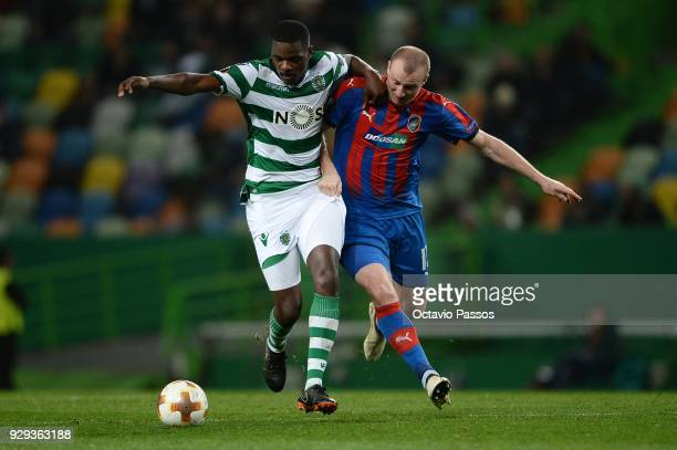 William Carvalho of Sporting Lisbon competes for the ball with Michal Krmencik of Viktoria Plzen during the UEFA Europa League Round of 16 first leg...