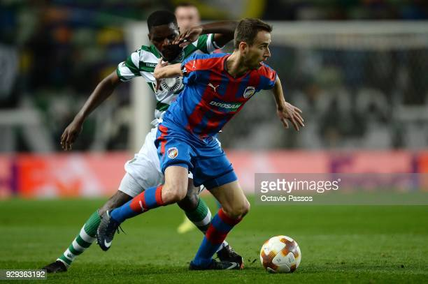 William Carvalho of Sporting Lisbon competes for the ball with Tomas Horava of Viktoria Plzen during the UEFA Europa League Round of 16 first leg...