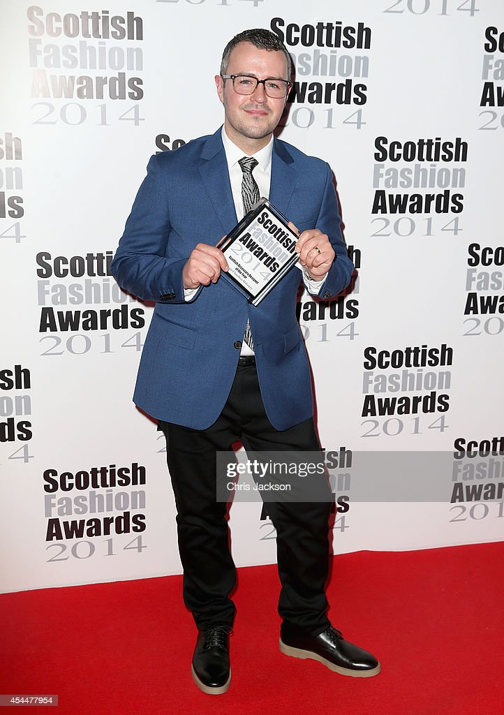 William Chambers poses with the Scottish Accessory Designer Award as he attends The Scottish Fashion Awards on September 1, 2014 in London, England.