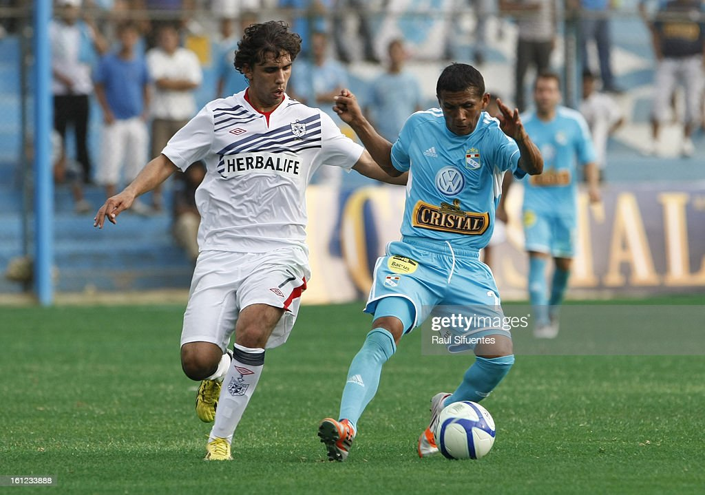 William Chiroque of Sporting Cristal fights for the ball with Juan Diego Gutierrez of San Martin during a match between Sporting Cristal and San Martin as part of The 2013 Torneo Descentralizado at the Alberto Gallardo Stadium on February 09, 2013 in Lima, Peru