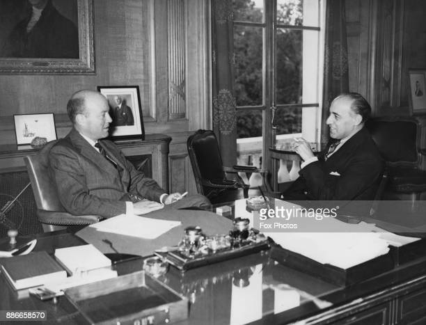 William Christian Bullitt Jr the United States ambassador to France chats with Laurence Adolph Steinhardt the new US ambassador to the Soviet Union...