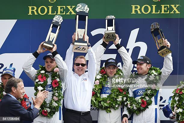 William Clay Ford Jr and drivers Germany's Dirk Mueller France's Sebastien Bourdais and US Joey Hand celebrate on the podium after winning the LMGTE...