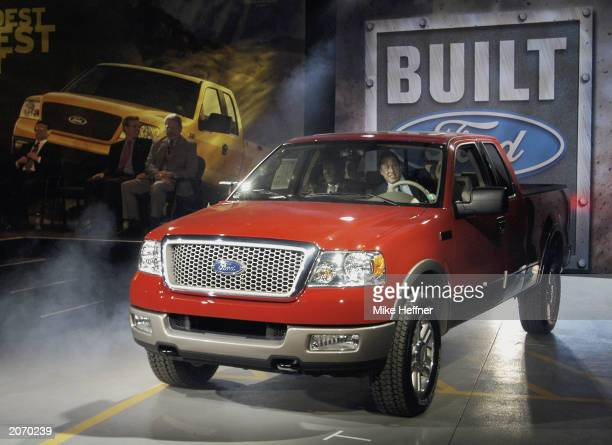 William Clay Ford Jr CEO and chairman of Ford Motor Company drives the first 2004 Ford F150 pickup truck off the assembly line to its official...