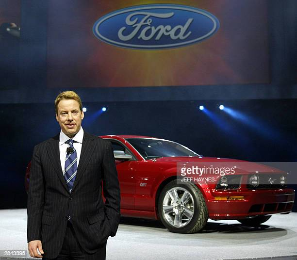 William Clay Ford Jr Chairman and CEO Ford Motor Company stand next to the 2005 Ford Mustang 04 January 04 during the press days at the North...