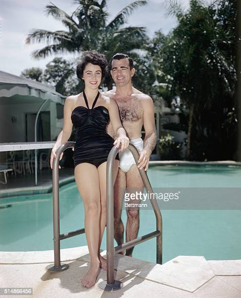 William D Pawley Jr and his fiancee 17yearold Elizabeth Taylor relaxing poolside in August 1949 at the Miami Beach home of Pawley's father a former...