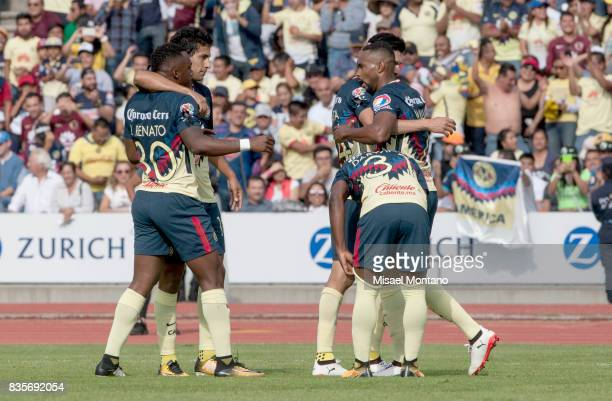 William da Silva of America celebrates with teammates after scoring the first goal of his team during the fifth round match between Lobos BUAP and...
