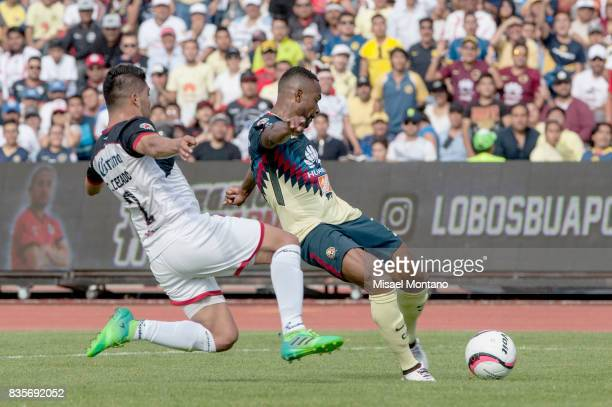 William Da Silva of America shoots to score the first goal of his team during the fifth round match between Lobos BUAP and America as part of the...