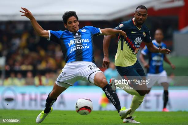 William Da Silva of America struggles for the ball with Jaime Gomez of Queretaro during the 1st round match between America and Queretaro as part of...