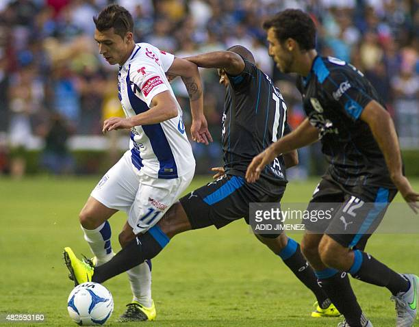 William Da Silva of Gallos Blancos de Queretaro vies for the ball with Ruben Botta of Pachuca during the Mexican Apertura football tournament match...