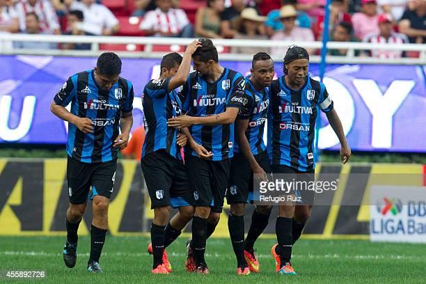 William da Silva of Queretaro celebrates with his teammates after scoring the third goal of his team during a match between Chivas and Queretaro as...