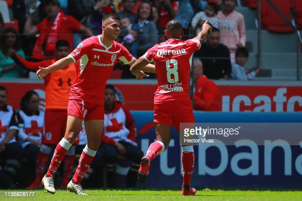 William Da Silva of Toluca celebrates with Alan Medina of Toluca after scoring the first goal of his team during the 13th round match between Toluca...
