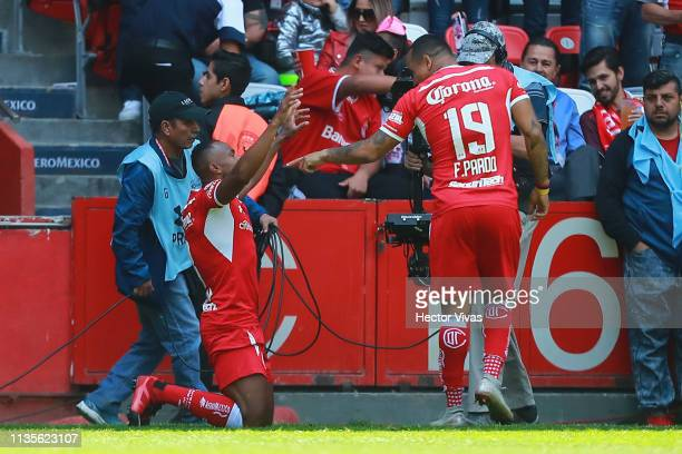 William Da Silva of Toluca celebrates with Edgar Pardo of Toluca after scoring the first goal of his team during the 13th round match between Toluca...