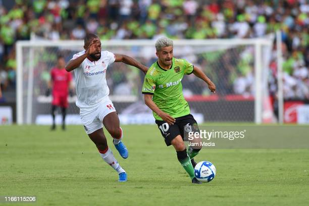 William Da Silva of Toluca fights for the ball with Edy Brambila of Juarez during the 3rd round match between FC Juarez and Toluca as part of the...