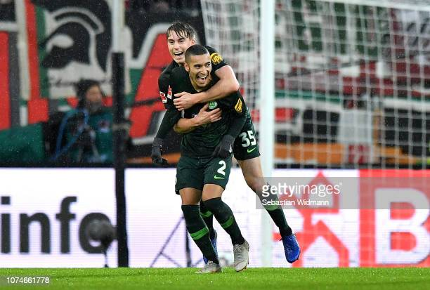 William de Asevedo Furtado of VfL Wolfsburg celebrates with John Anthony Brooks of VfL Wolfsburg after scoring his sides second goal during the...