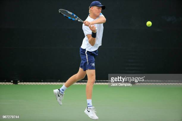 William de Quant of the Middlebury Panthers hits a backhand against the Bowdoin Polar Bears during the Division III Men's Tennis Championship held at...