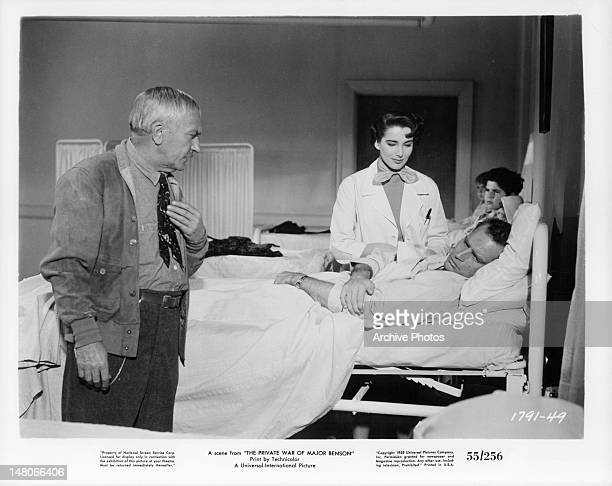 William Demarest and Julie Adams at the hospital bed of Charlton Heston in a scene from the film 'The Private War Of Major Benson' 1955