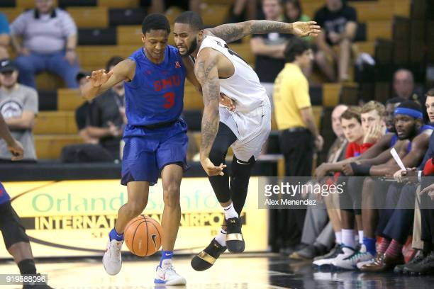 William Douglas of the Southern Methodist Mustangs fouls Dayon Griffin of the UCF Knights during a NCAA basketball game at the CFE Arena on February...