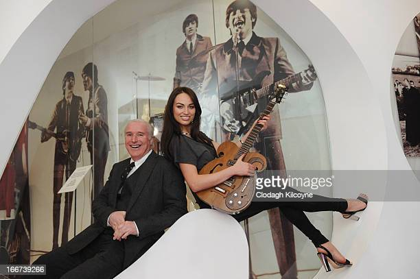 William Doyle CEO of Newbridge Silverware and Model Daniella Moyles display a rare Vox guitar played by George Harrison and John Lennon which is...