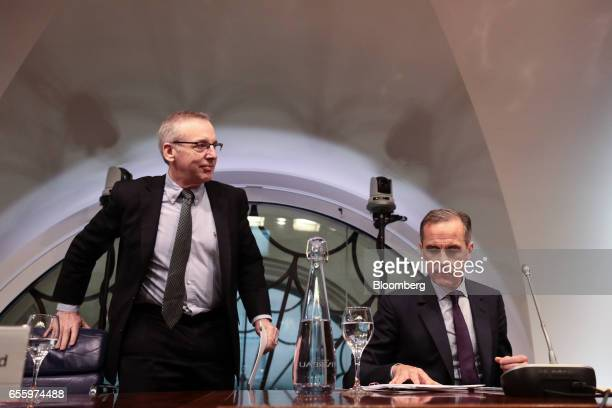William Dudley president and chief executive officer of the Federal Reserve Bank of New York left stands next to Mark Carney governor of the Bank of...