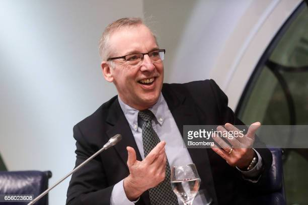 William Dudley president and chief executive officer of the Federal Reserve Bank of New York gestures as he speaks during a panel discussion on...