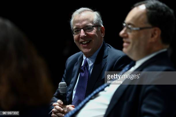 William Dudley president and chief executive officer of the Federal Reserve Bank of New York left reacts as Andrew Bailey chief executive officer of...