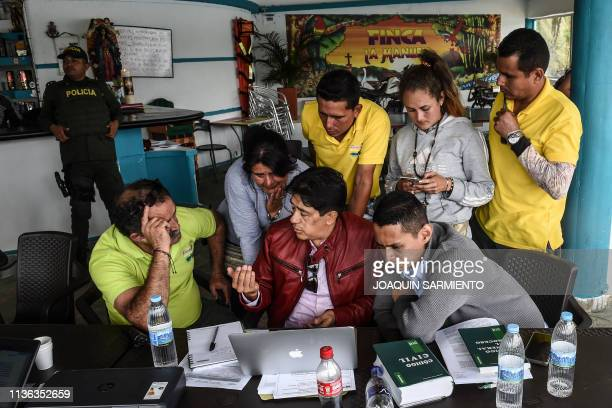William Duque Escobar's former gardener is pictured with his relatives and lawyers during and eviction procedure at La Manuela a former vacation...