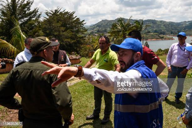 William Duque Escobar's former gardener listens to local authorities and members from the Special Assests Society office during and eviction...
