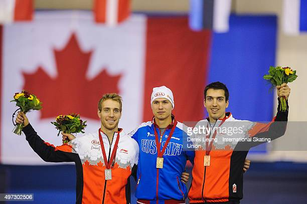 William Dutton of Canada Pavel Kulizhnikov of Russia and Alex BoisvertLacroix take the podium after the Men's 500m during the ISU World Cup Speed...