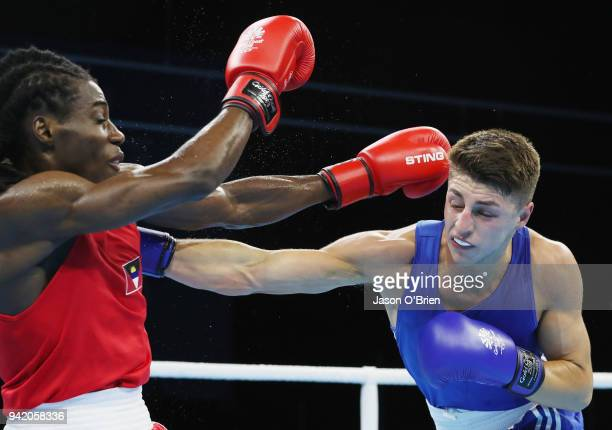 William Edwards of Wales competes against Ryan Alston of Antigua during the Boxing on day one of the Gold Coast 2018 Commonwealth Games at Oxenford...