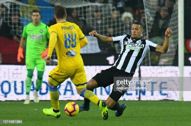 William Ekong of Udinese Calcio competes for the ball with Andrea Pinamonti of Frosinone Calcio during the Serie A match between Udinese and...
