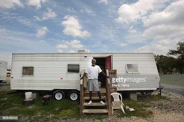 William Eskridge stands on the front porch of his FEMA trailer in the FEMA Diamond travel trailer park March 22 2008 in Port Sulphur Louisiana The...