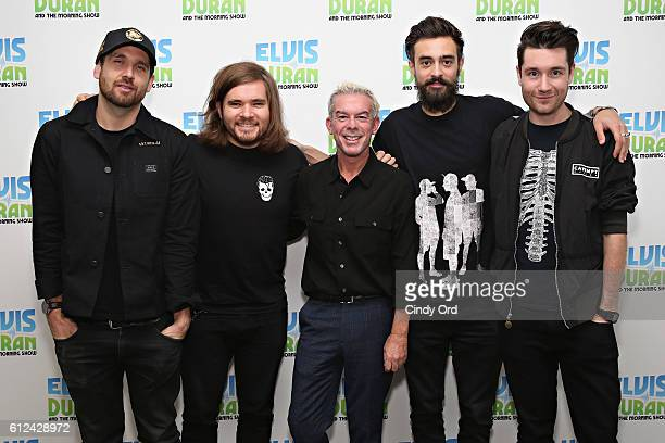 William Farquarson Chris 'Woody' Wood Kyle J Simmon and Dan Smith of Bastille pose for a photo with Elvis Duran during a visit to 'The Elvis Duran...