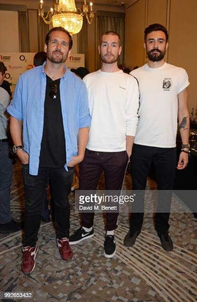 William Farquarson Dan Smith and Kyle J Simmons of Bastille attend the Nordoff Robbins O2 Silver Clef Awards at The Grosvenor House Hotel on July 6...