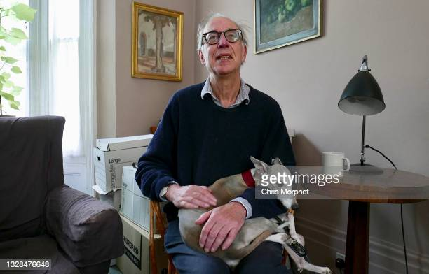William Feaver, biographer, art critic, artist and lecturer with his dog Flint, London, 27th July 2017.